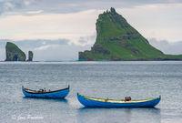blue boats, Drangarnir, Tindholmur, Bour, Vagar, Faroe Islands, North Atlantic ocean, summer