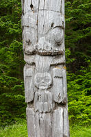 Grizzly Bear and Human Infant Mortuary Pole, SGang Gwaay, Ninstints, Nans Dins, Anthony Island, Gwaii Haanas National Park Reserve, Haida Gwaii, British Columbia, Pacific Ocean, Canada, Summer