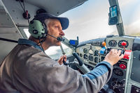 de Havilland DHC-2 Beaver, Pilot, Cockpit, Gwaii Haanas National Park Reserve, Haida Gwaii, British Columbia, Pacific Ocean, Hecate Strait, Canada, Summer