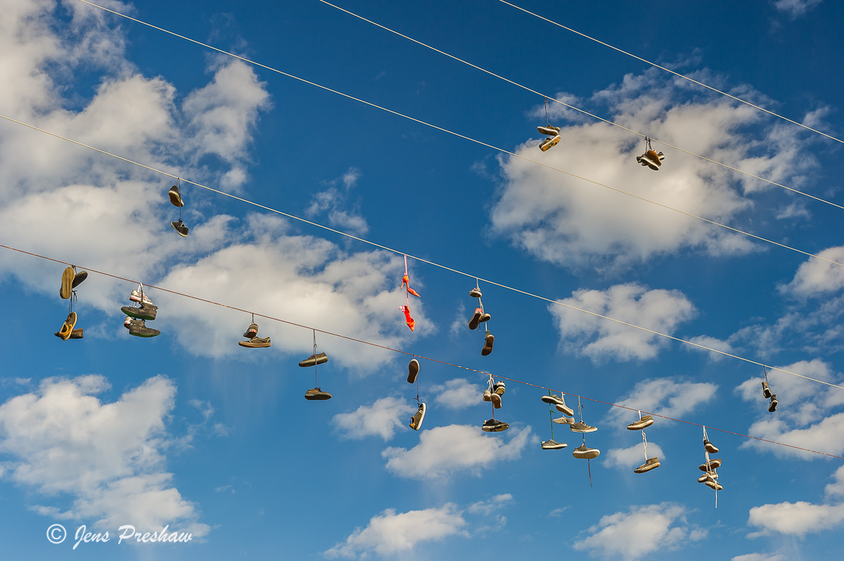 shoefiti, shoe tossing, power lines, telephone cables, Tofino, Vancouver Island, British Columbia, Pacific Northwest, Canada, summer , photo