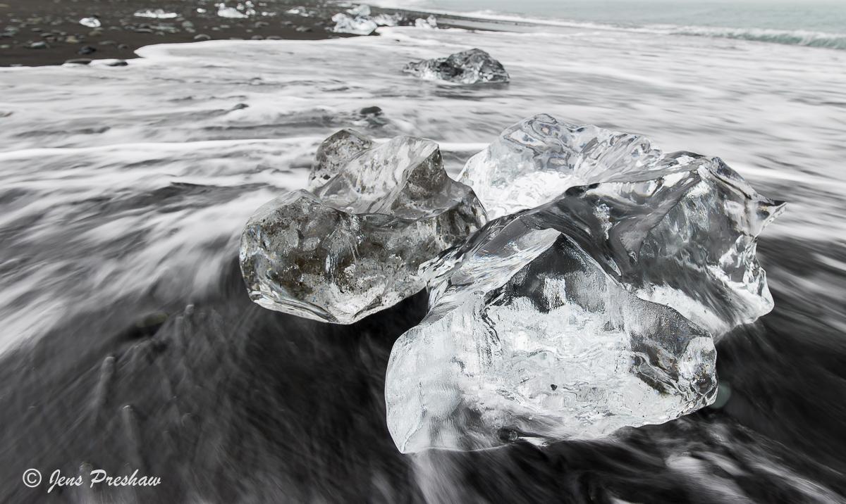 Glacial Ice Chunks, black volcanic sand, Jokulsarlon, South Iceland, North Atlantic Ocean, Summer , photo