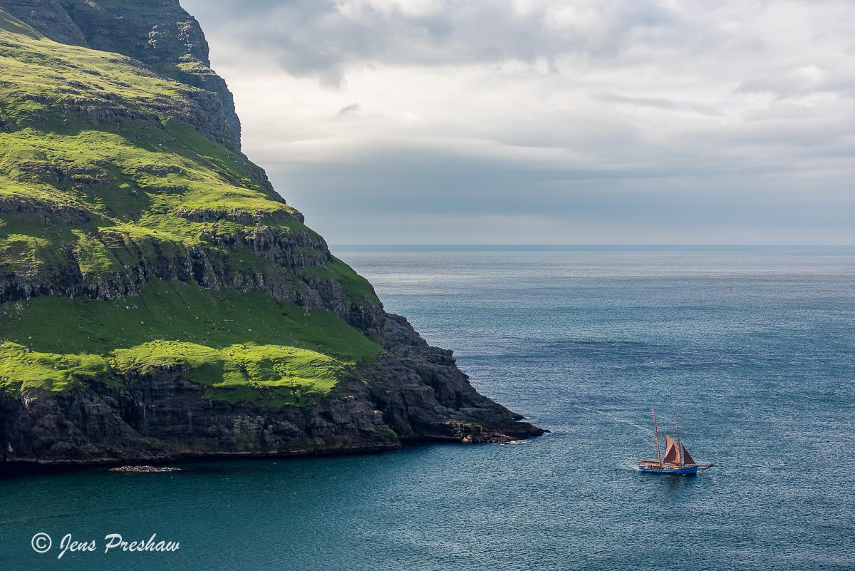 blue wooden sailing ship, Tjornuvik, Eioi, Streymoy, Sundini, North Atlantic ocean, Faroe Islands, summer, photo