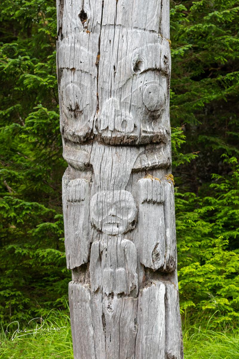 Grizzly Bear and Human Infant Mortuary Pole, SGang Gwaay, Ninstints, Nans Dins, Anthony Island, Gwaii Haanas National Park Reserve, Haida Gwaii, British Columbia, Pacific Ocean, Canada, Summer, photo
